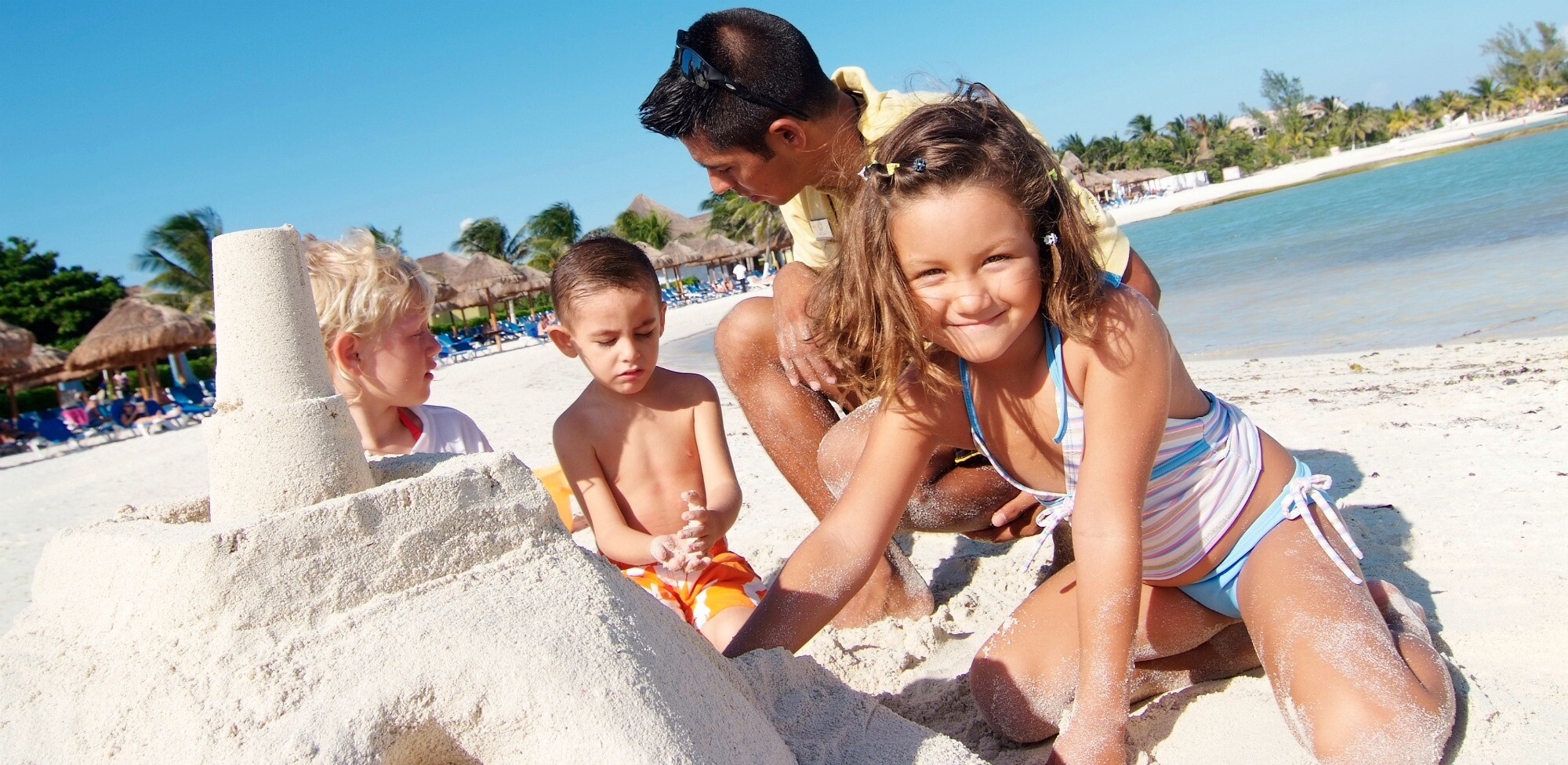 Family building sand castle