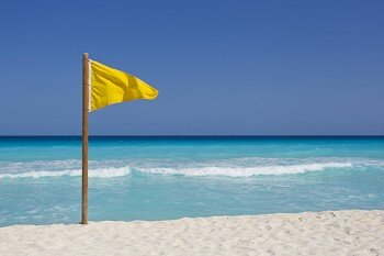 what does a yellow flag at the beach mean
